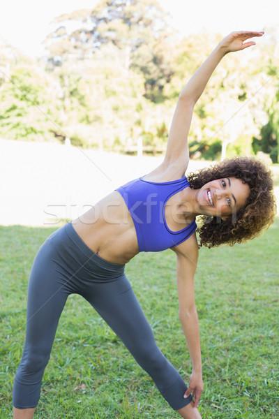 Sporty woman stretching in park Stock photo © wavebreak_media