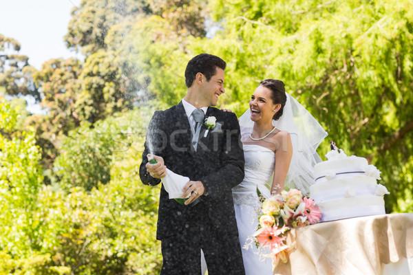 Friss házas pár vőlegény nyitás pezsgő üveg Stock fotó © wavebreak_media