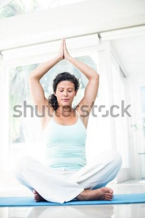 Full length portrait of a sporty men in meditation pose Stock photo © wavebreak_media