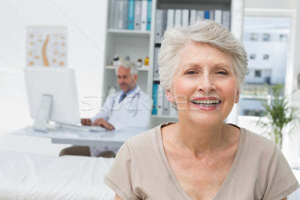 Happy senior patient with doctor at medical office Stock photo © wavebreak_media