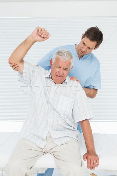 Senior man hand mannelijke medische kantoor Stockfoto © wavebreak_media