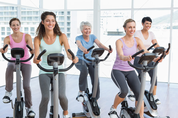 Happy women working out at spinning class Stock photo © wavebreak_media