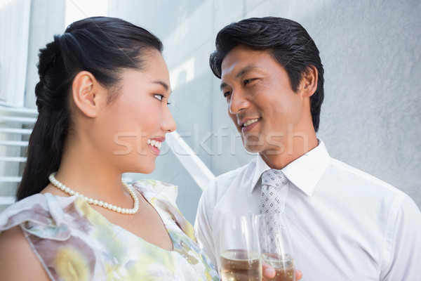 Happy couple dressed up for a date having champagne Stock photo © wavebreak_media