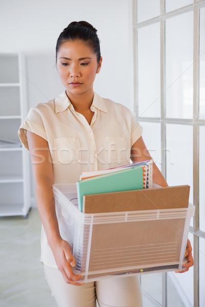 Femme d'affaires boîte choses bureau entreprise Photo stock © wavebreak_media