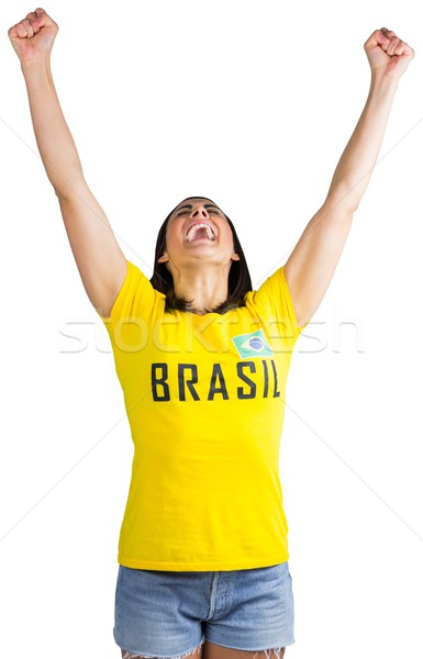 Excited football fan in brasil tshirt Stock photo © wavebreak_media