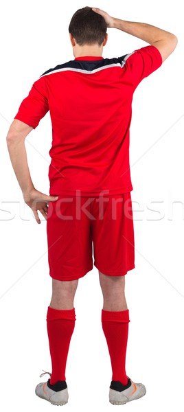 Disappointed football player looking down Stock photo © wavebreak_media