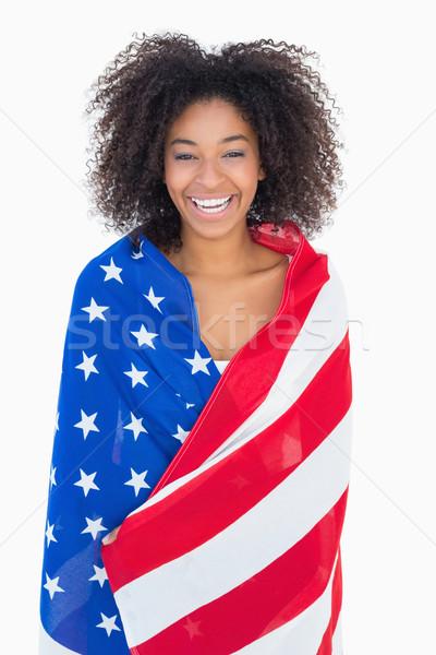 Bastante menina bandeira americana sorridente câmera branco Foto stock © wavebreak_media
