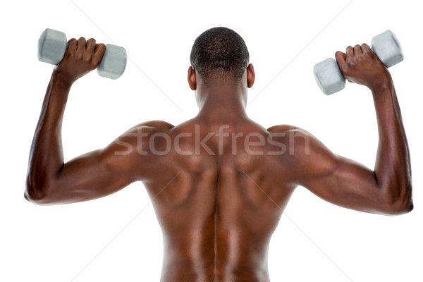 Vista posteriore montare a torso nudo uomo manubri Foto d'archivio © wavebreak_media