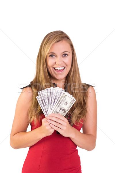 Pretty blonde showing wad of cash Stock photo © wavebreak_media