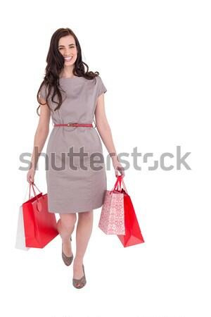 Elegáns barna hajú bevásárlótáskák fehér női mosolyog Stock fotó © wavebreak_media