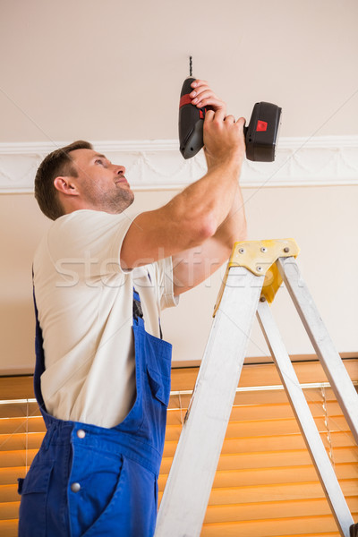 Handyman using a cordless drill to the ceiling Stock photo © wavebreak_media