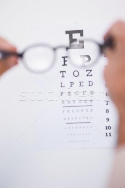 очки для чтения глядя белый рук человека Сток-фото © wavebreak_media