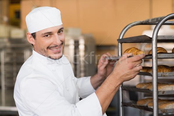 Baker checking freshly baked bread Stock photo © wavebreak_media