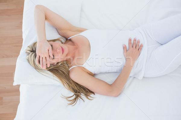 Mulher loira sofrimento estômago dor casa quarto Foto stock © wavebreak_media
