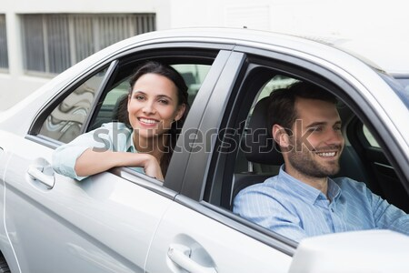 Young couple smiling and waving Stock photo © wavebreak_media