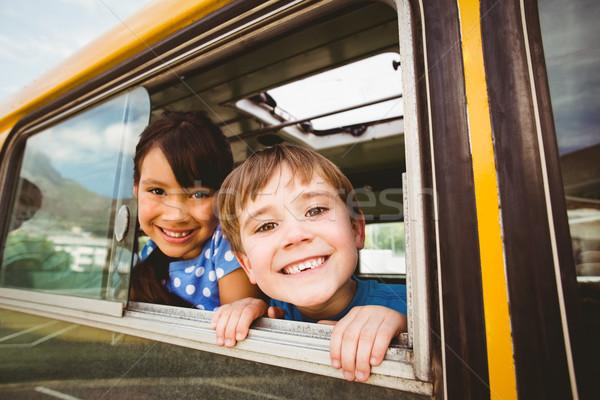 Aranyos iskolás mosolyog kamera iskolabusz kívül Stock fotó © wavebreak_media