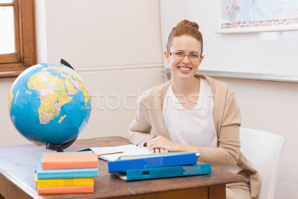 Teacher in classroom with globe  Stock photo © wavebreak_media