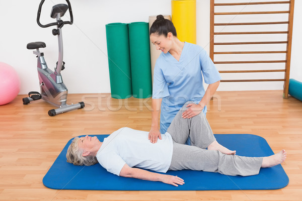 Therapist working with senior woman on exercise mat  Stock photo © wavebreak_media