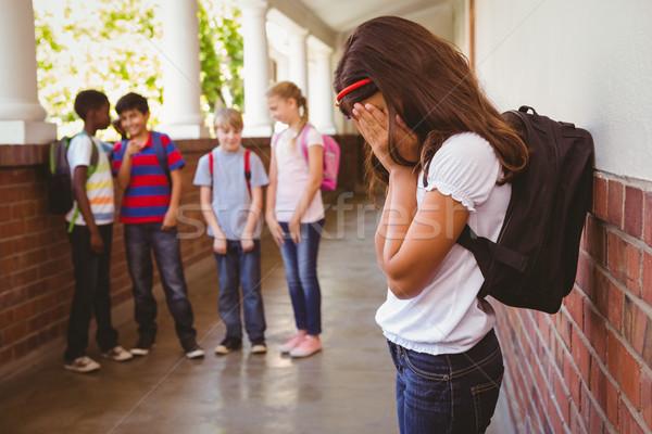 Smutne uczennica znajomych szkoły korytarz widok z boku Zdjęcia stock © wavebreak_media
