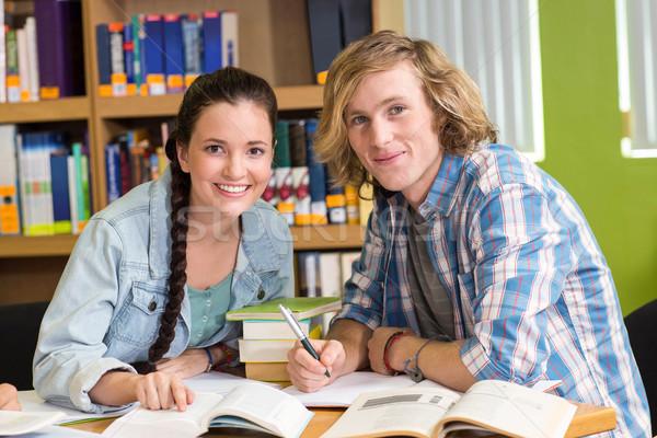 Főiskola diákok házi feladat könyvtár portré nő Stock fotó © wavebreak_media