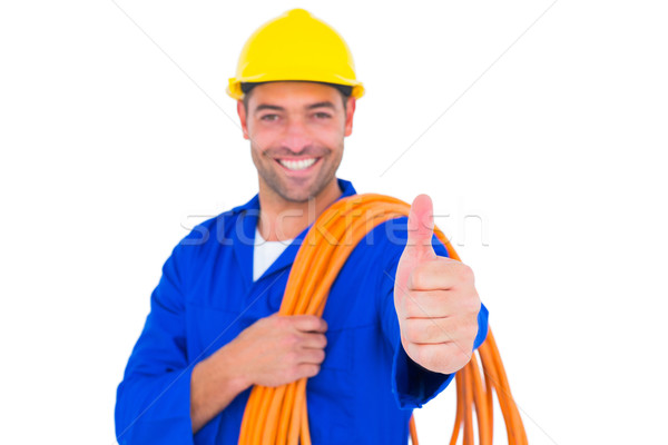 Electrician with rolled wire gesturing thumbs up Stock photo © wavebreak_media