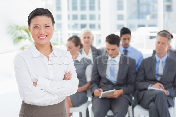 Business people looking at camera with arms crossed Stock photo © wavebreak_media