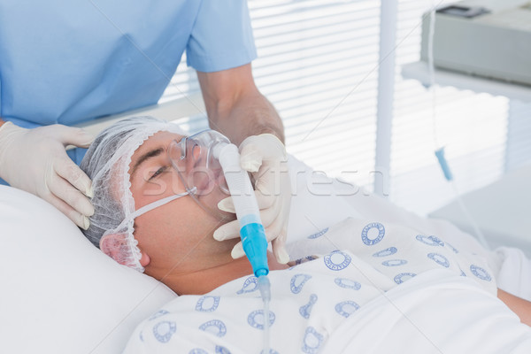 Doctor holding patients oxygen mask Stock photo © wavebreak_media