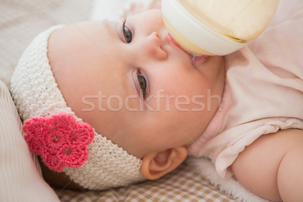Gyönyörű aranyos kislány baba üveg iszik Stock fotó © wavebreak_media