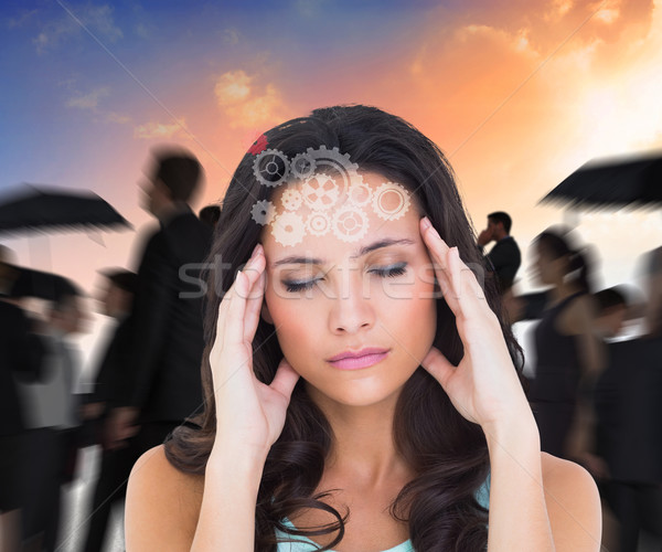 Composite image of pretty brunette with a headache Stock photo © wavebreak_media
