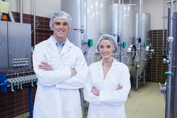 Feliz científicos posando los brazos cruzados fábrica industria Foto stock © wavebreak_media
