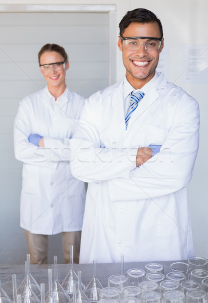 Zdjęcia stock: Uśmiechnięty · naukowcy · patrząc · kamery · laboratorium