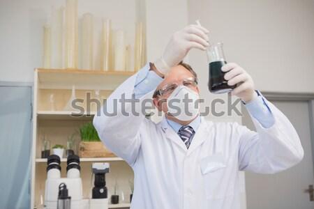 Scientist grinding powder with mortar Stock photo © wavebreak_media