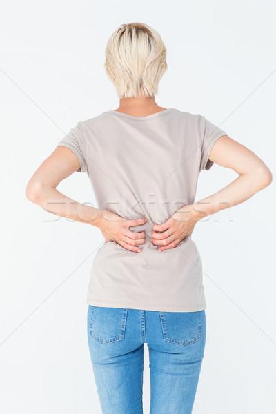 Blonde vrouw Maakt een reservekopie pijn witte pijn Stockfoto © wavebreak_media