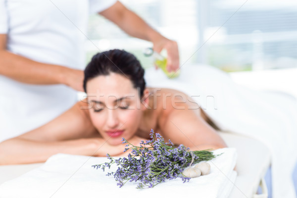 Smiling woman getting an aromatherapy treatment Stock photo © wavebreak_media