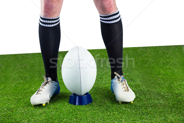 Rugby player ready to make a drop kick stock photo