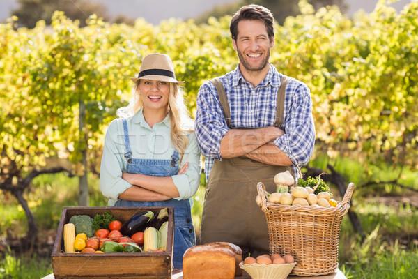 Happy farmer couple with arms crossed Stock photo © wavebreak_media
