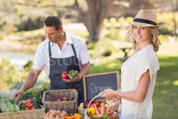 Blonde customer buying some vegetables Stock photo © wavebreak_media