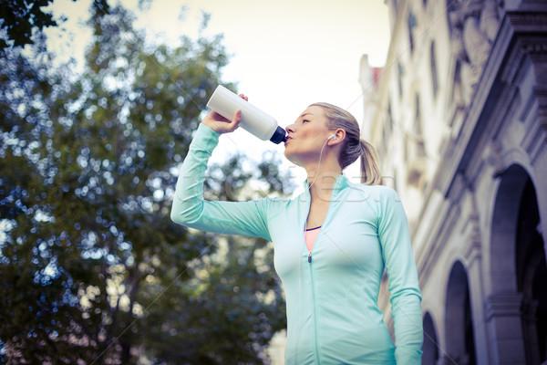 Gyönyörű nő ivóvíz napos idő víz város sport Stock fotó © wavebreak_media