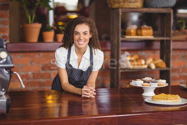 Smiling barista leaning on counter Stock photo © wavebreak_media