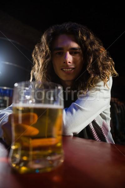 Man holding beer mug in bar Stock photo © wavebreak_media