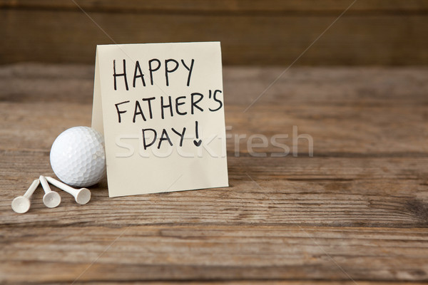 Fathers day greeting card by golf ball on table Stock photo © wavebreak_media
