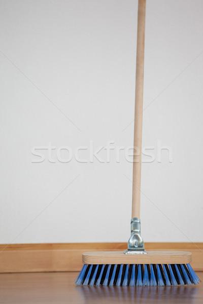 Sweeping broom with wooden handle on floor Stock photo © wavebreak_media