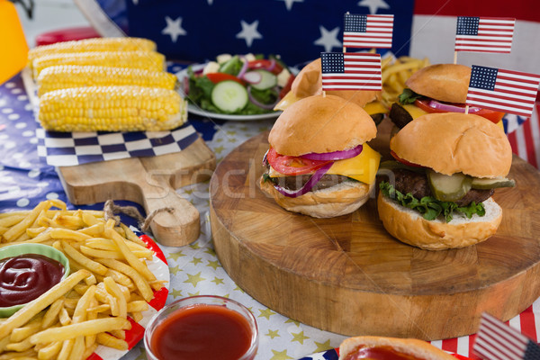 Burgers and corn cob on wooden table with 4th july theme Stock photo © wavebreak_media