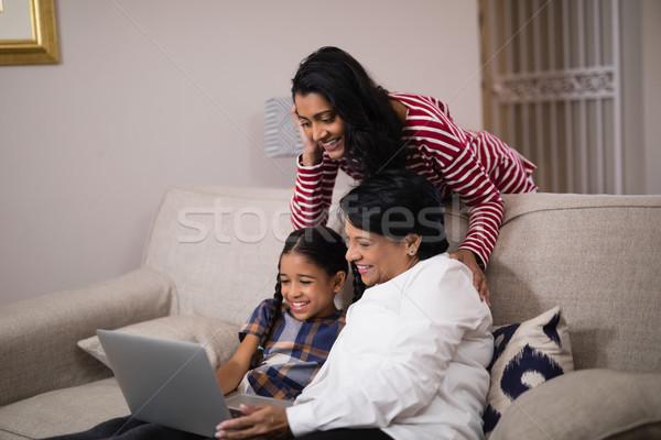 счастливым семьи используя ноутбук вместе домой девушки Сток-фото © wavebreak_media