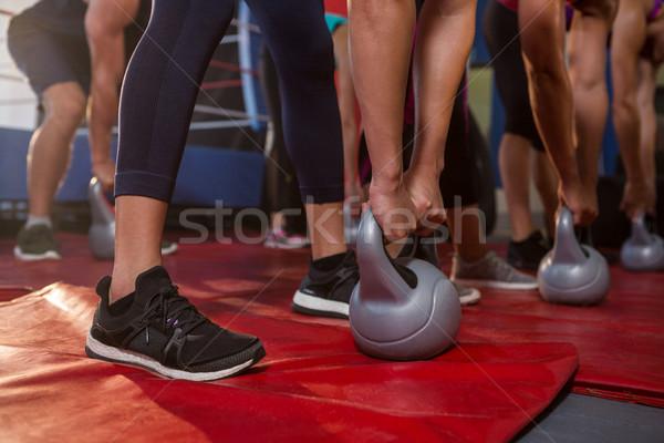 Alacsony részleg sportolók testmozgás fitnessz tornaterem Stock fotó © wavebreak_media