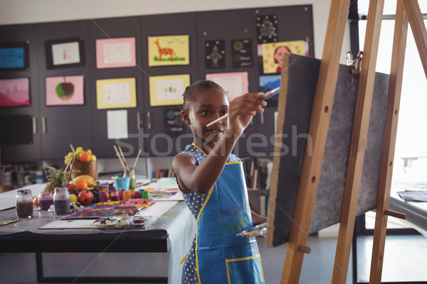 Fille peinture toile classe papier bois Photo stock © wavebreak_media