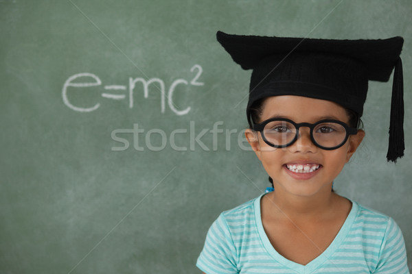 Young girl with graduation hat against chalk board Stock photo © wavebreak_media