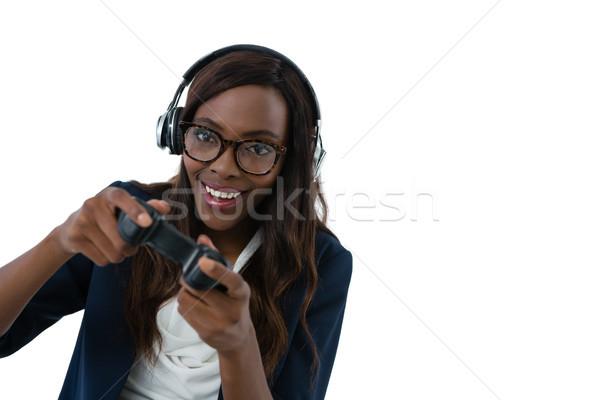 女性 着用 眼鏡 ヘッドホン 演奏 ビデオゲーム ストックフォト © wavebreak_media