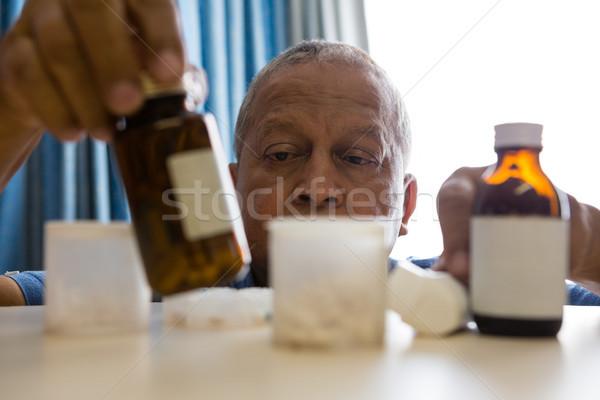 Senior man taking medicines in nursing home Stock photo © wavebreak_media