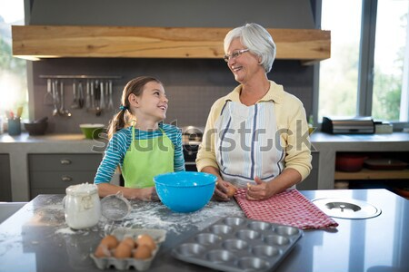 Grandmother and granddaughter cutting dough with a cookie cutter Stock photo © wavebreak_media